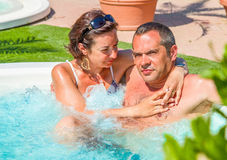 Pair of lovers in the jacuzzi Stock Photo