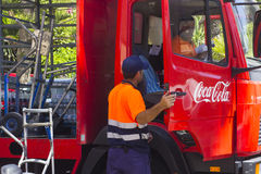 A pair of male employees make a delivery of Coca Cola to a local supermarket in Playa Las Americas in the canary island of Tenerif Royalty Free Stock Image