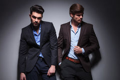 Pair of male models posing in studio Stock Photography