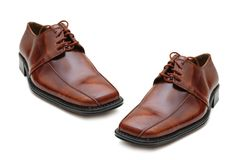 Pair of male shoes isolated. On the white Royalty Free Stock Images
