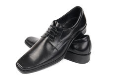Pair of man's black shoes. Isolated on white background Royalty Free Stock Photos
