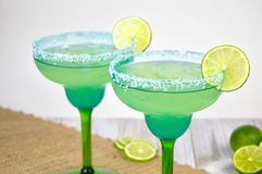 Pair of margaritas. In festive blue and green glasses against a white background Stock Images