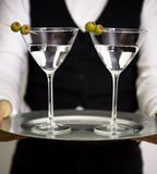 Pair of Martini. Two martini glasses on round silver tray Stock Photo