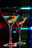 Pair of martini glass. With olive royalty free stock image