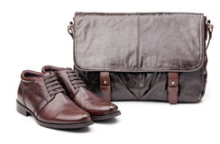Pair of men boots and messenger bag over white Stock Photo