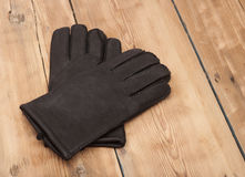 Pair of men's black leather gloves Stock Photos