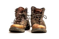 Pair of Men`s Dirty Beat Up Grungy Brown Leather Work Boots Isolated on White Background. Pair of Men`s Dirty Beat Up Worn Out Brown Leather Work Boots with Long royalty free stock image