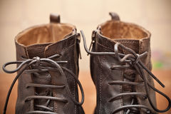Pair of men's fashion shoes. Tying closeup. Autumn and spring shoes stock photo
