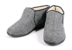 Pair of men's grey slippers on white background. Stock Photo