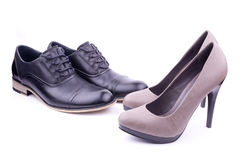 A pair of men's and women's shoes Royalty Free Stock Photos