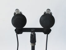 Pair of Microphones POV. POV angle of two microphones set up for a press conference Royalty Free Stock Photography