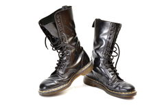 Pair of mid-calf 14 eyelet black lace-up boots Stock Photography