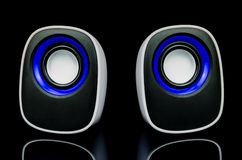 White speakers with reflection on black background Royalty Free Stock Images