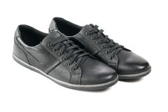 A pair of modern men`s sport shoes in black. Men`s shoes for sports Royalty Free Stock Photo