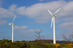 A pair of modern wind turbines located on the hill outside the village of Conlig in County Down Northern Ireland Stock Image