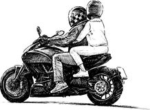 Pair on a motorbike Stock Photo