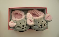 Pair of mouse slippers on white background. stock images