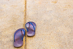 A pair of moving forward old brown rubber sandals Royalty Free Stock Image