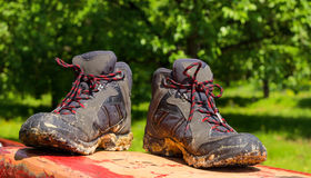 Pair of muddy boots. Outdoor stock images