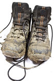 Pair muddy walking boots Royalty Free Stock Image