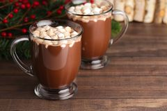 Pair of Mugs Filled with Hot Chocolate and Marshmallows on a Woo. A Pair of Mugs Filled with Hot Chocolate and Marshmallows on a Wooden Table stock photos