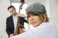 Pair of musicians wait their turn Royalty Free Stock Photos