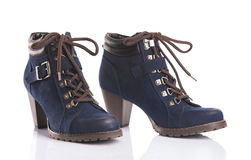 Pair of navy blue ankle boots Stock Photography