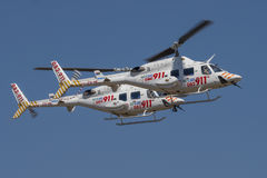 Pair of Netcare 911 helicopters in a fly past Royalty Free Stock Images