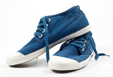 A pair of new blue shoes. On a white Stock Image