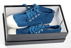 A pair of new blue shoes. On the shoe box Royalty Free Stock Photo