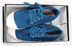 A pair of new blue shoes in a shoe box Royalty Free Stock Image