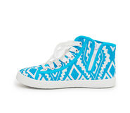 Pair of new blue sneakers on white background Royalty Free Stock Photography