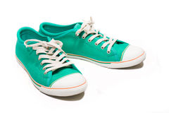 Pair of new green sneakers. Isolated on white royalty free stock photography