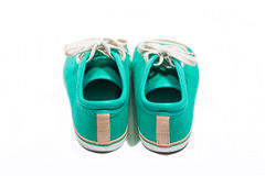 Pair of new green sneakers Stock Photography