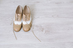 Pair of new shoes. Pair of new unlaced womans shoes on a white wooden floor Stock Image