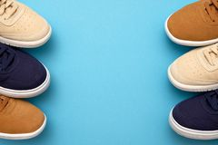 Pair of new sneakers on blue background. Top view royalty free stock photography