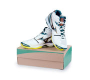 Pair of new sneakers on cardboard box Royalty Free Stock Photography
