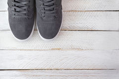 Pair of new stylish Skateboard shoes for men in grey color on wh Royalty Free Stock Images