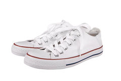 Pair of new white sneakers Stock Photo