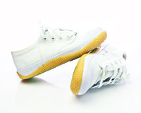 Pair of new white sneakers on white background Royalty Free Stock Image