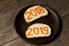 Pair of new year 2018 and 2019 sandwiches with red caviar royalty free stock photography