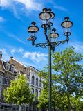 A pair of Nike sneakers hanging by the laces from a street lamp, a shoe dangling in Maastricht, Netherlands royalty free stock images