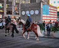 Pair of NYPD police horses and there riders seen on patrol in Times Square, New York City, USA. stock image