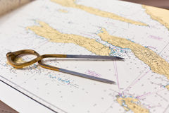 Free Pair Of Compasses For Navigation On A Sea Map Royalty Free Stock Photography - 41694927