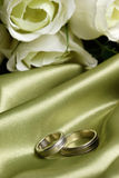 Pair Of Wedding Bands On Green Satin Royalty Free Stock Photography