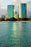 Pair of office buildings in Honolulu reflect in bay Royalty Free Stock Photos