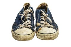Pair of old blue sneakers. Pair of old dirty worn out blue sneakers in children size isolated on white background with copy space for text royalty free stock photos