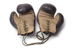 A pair of an old boxing gloves. Isolated image a pair of old fashioned boxing gloves Royalty Free Stock Photography