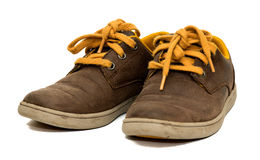 Pair of old brown colored shoes isolated Royalty Free Stock Photography