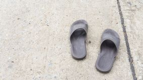 Pair of old brown sandal on concrete floor. Copy space for text. keep walking concept Stock Photography